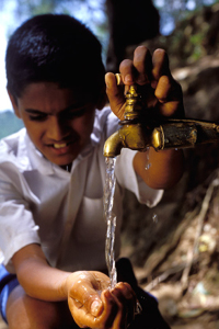 Boy getting water from community water pipe. Sri Lanka.  © Dominic Sansoni / World Bank