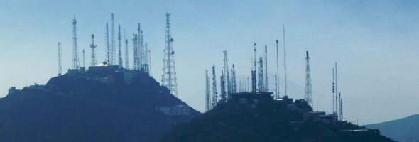 Television broadcast towers line a mountain outside Kabul, Afghanistan. © UN Photo/Aurora Alambra